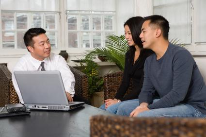 asian couple with financial advisor